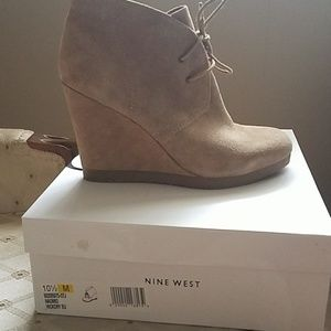 Nubuck nude wedge booties. Never worn